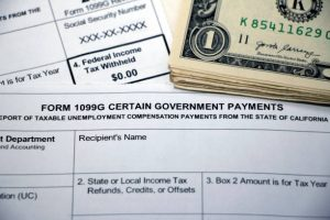 Closeup of overlapping tax forms, Form 1099G