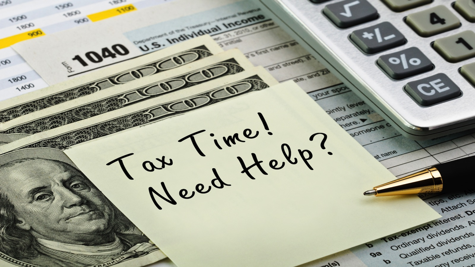 """Build Wealth. Yellow post-it note with """"Tax Time! Need Help?"""" written on it"""